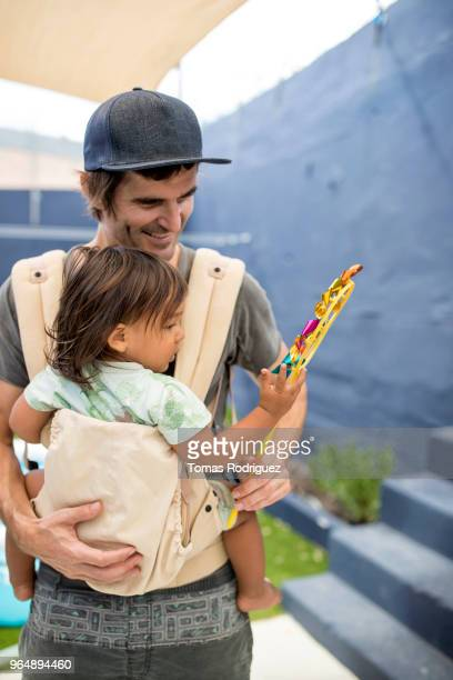 Father with a toddler holding a pinwheel toy