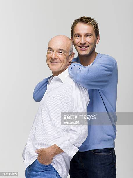 Father with son smiling, portrait, close-up