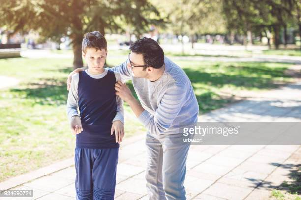father with autistic son - autism awareness stock pictures, royalty-free photos & images