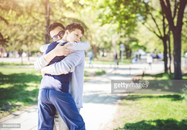 father with autistic son - autism spectrum disorder stock photos and pictures