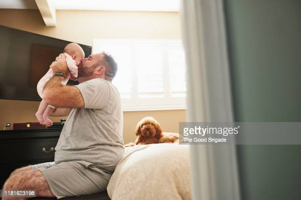 father with baby girl in bedroom - lgbtq  and female domestic life fotografías e imágenes de stock
