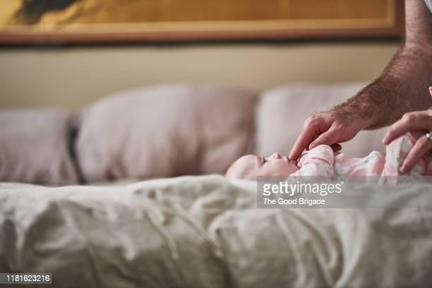 father with baby girl in bedroom - behaarte männer stock-fotos und bilder