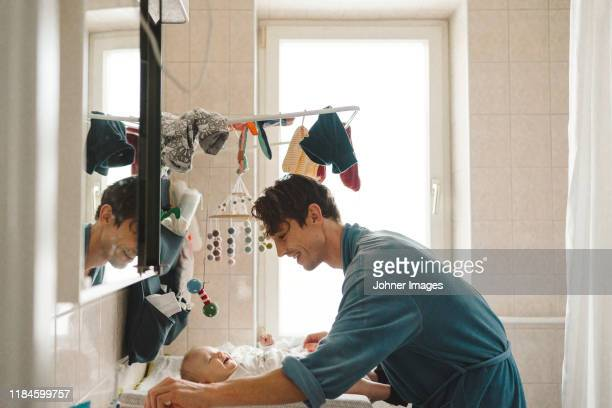 father with baby - paternity leave stock pictures, royalty-free photos & images