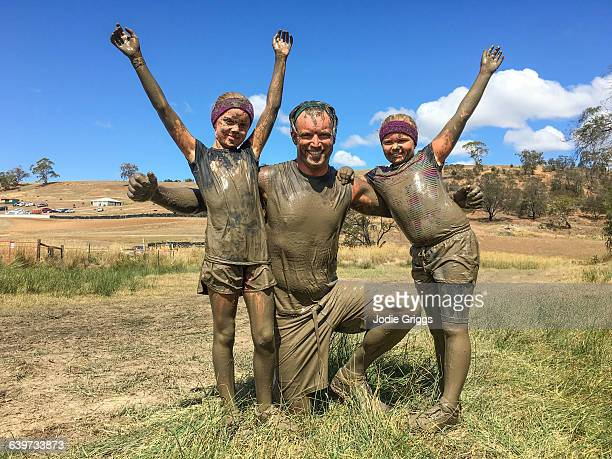 Father with children after completing a mud run