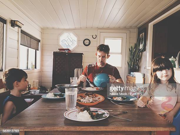 Father With Children Having Lunch At Home