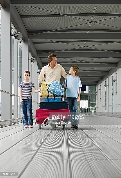 Father with children in airport