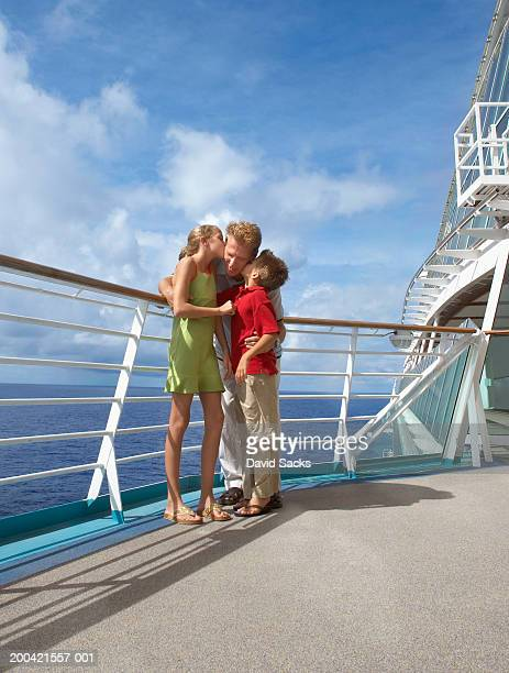 father with children (10-12) on cruise ship - nave foto e immagini stock
