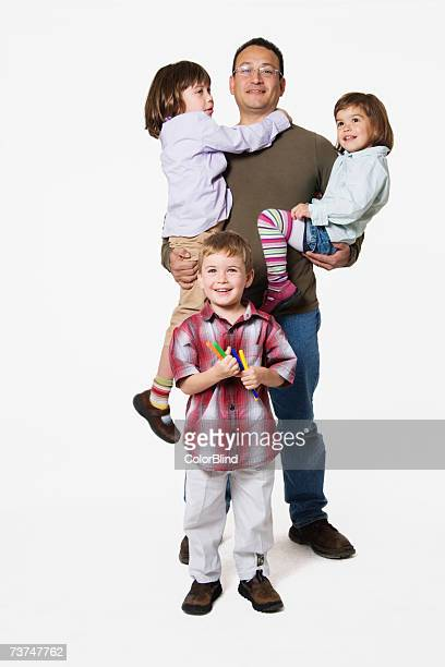 Father with children (3-7) smiling