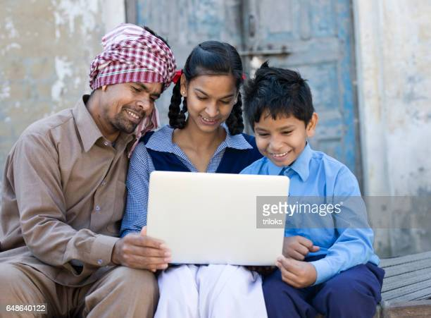 father with children using laptop - asian boy stock pictures, royalty-free photos & images