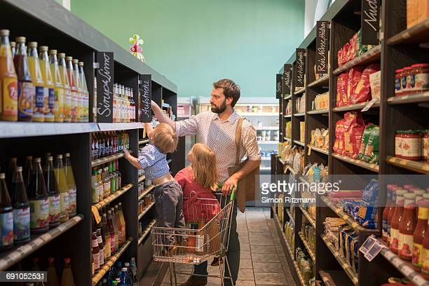 Father with daughter and son grocery shopping