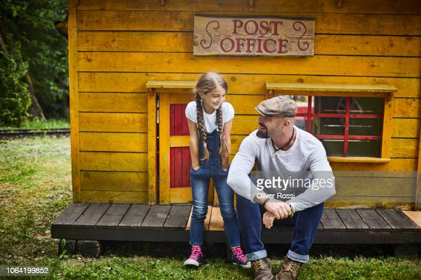 Father with daughter at a hut in an amusement park