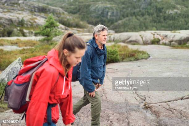 Father with daughter hiking in Norway mountains