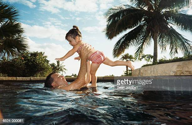Father with Daughter in Pool