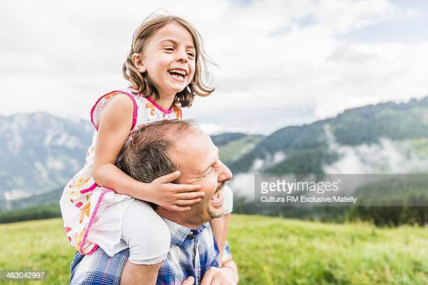 Father with daughter on shoulders, Tyrol, Austria
