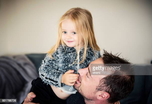 Father with daughter on sofa