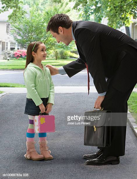 Father with daughter (4-5) on street