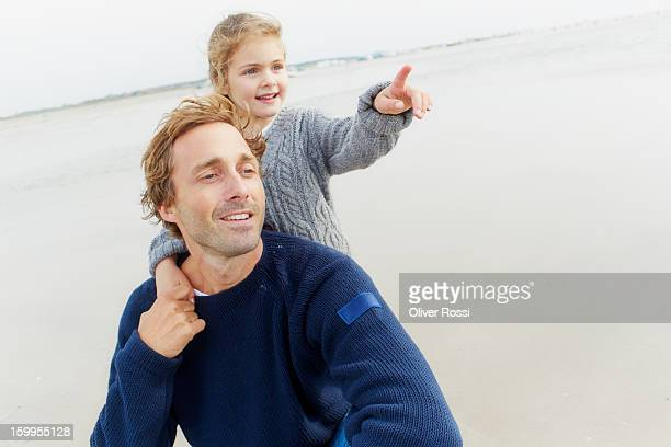 Father with daughter on the beach