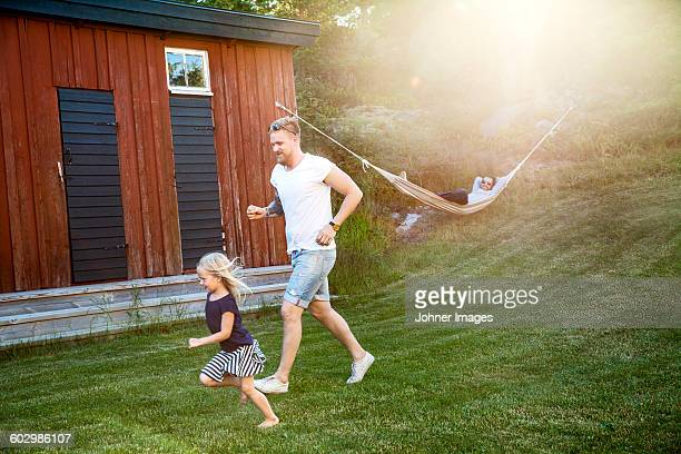 Father with daughter playing in garden