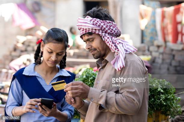 father with daughter shopping online using credit card - rural scene stock pictures, royalty-free photos & images