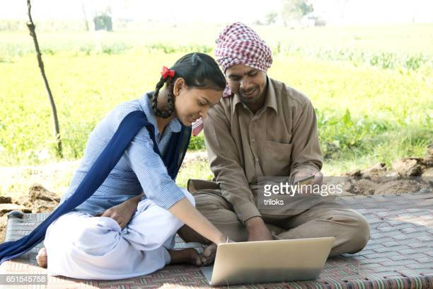 Father with daughter shopping online using credit card