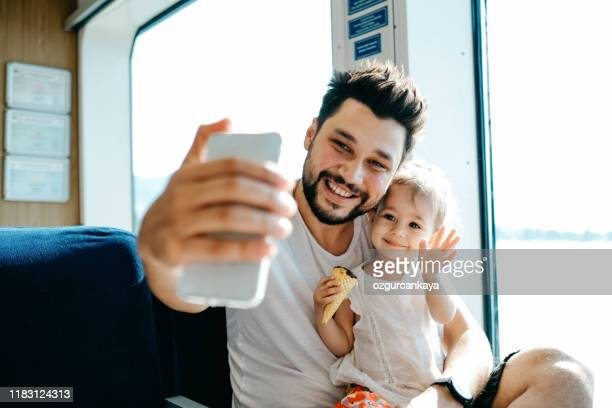father with daughter taking selfie - facetime stock pictures, royalty-free photos & images