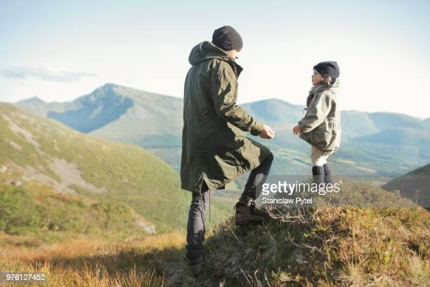 Father with daughter trekking in mountains
