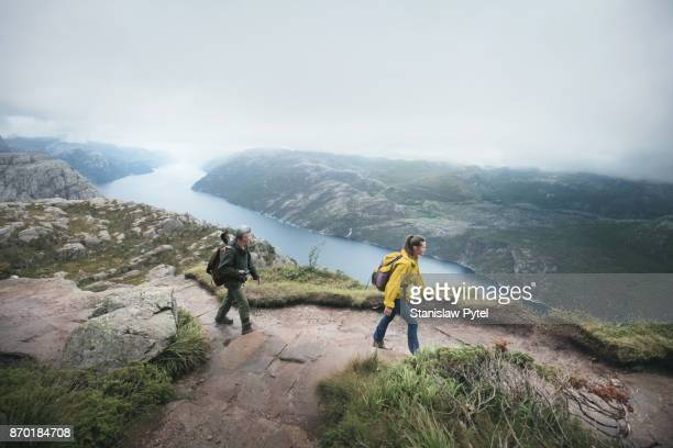 Father with daughter wallking in high mountains in Norway
