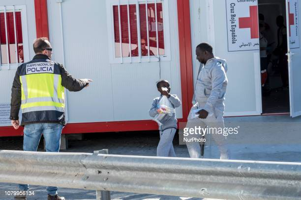 A father with his child leaves the Care unit to take a bus to go to a center on January 9 Malaga Southern Spain