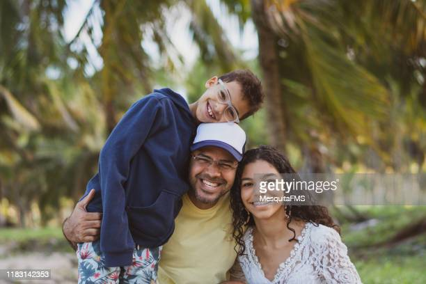 father with his children looking at camera - latin american culture stock pictures, royalty-free photos & images
