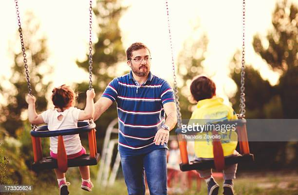 Father with his kids in a playground