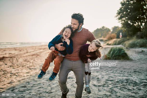 father with his kids - father stock pictures, royalty-free photos & images