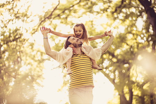 Father with his little girl playing in nature. Spring season. 974699106