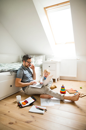 Father with his little son working from home - gettyimageskorea