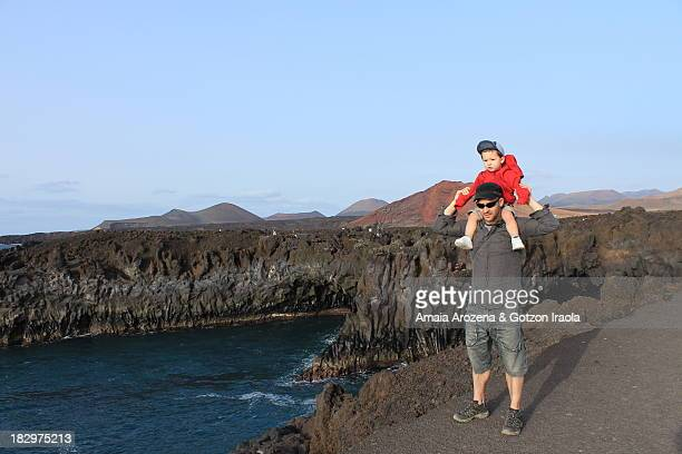 Father with his son in Hervideros (Lanzarote)
