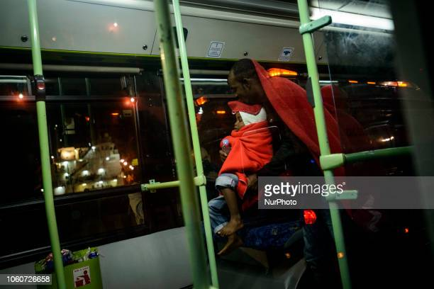 A father with his young son onto the bus to be transferred to the Red Cross tent Malaga The Maritime Spanish Vessel SAR Mastelero rescued three...