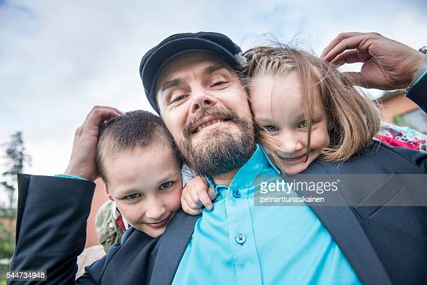 Father with kids outdoors.
