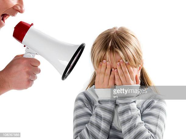 father with megaphone yelling on his daughter - nasty little girls stock photos and pictures