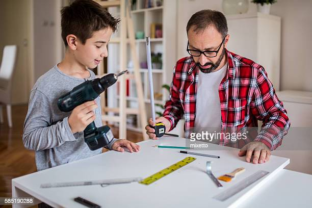 Father with son carpenters at home