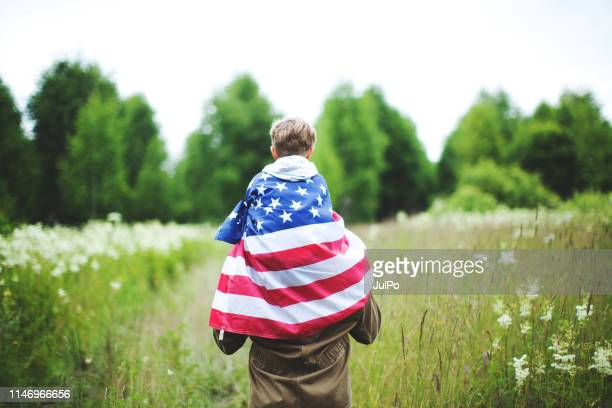 father with son celebrating independence day - patriotic stock pictures, royalty-free photos & images