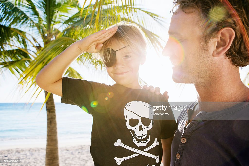 Father with son (8-9) dressed as pirate : Photo