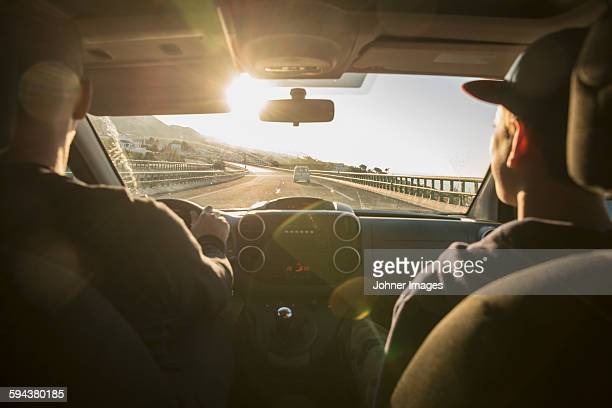 father with son driving in car - family inside car stock photos and pictures
