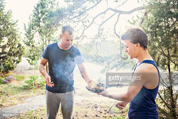 Father with son having barbecue