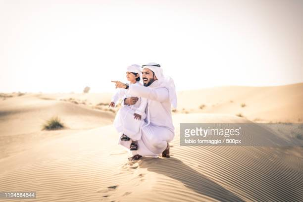 father with son on desert - two generation family stock pictures, royalty-free photos & images