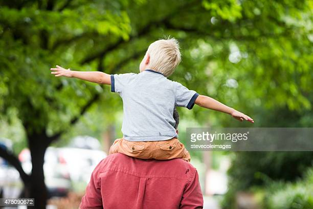 Father with son on shoulders.