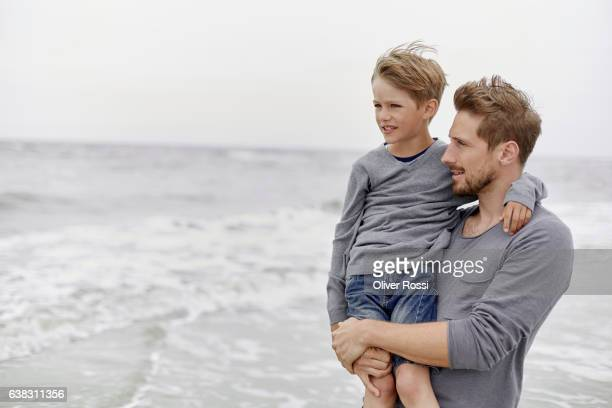 Father with son on the beach