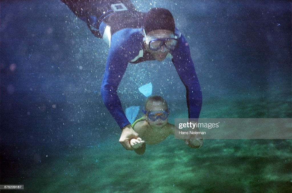 Father with son underwater : Stock Photo