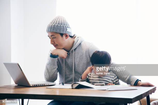 Father with son working at home