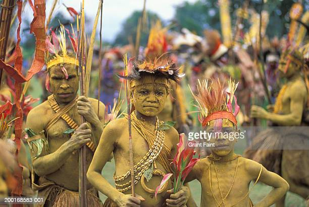Father with sons (6-10) in tribal costume, portrait