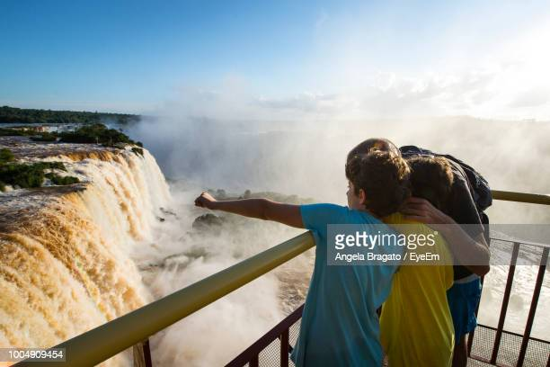 Father With Sons Looking At Iguacu Falls