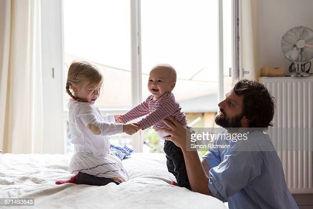 father with toddler daughter and baby son. - vida de bebé fotografías e imágenes de stock